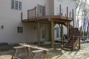 Deck during construction and bare soil rear yard