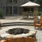 Firepit and multi-level patio create appealing outdoor living spaces