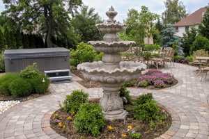 Focal water fountain with hot tub and dining areas niches in background