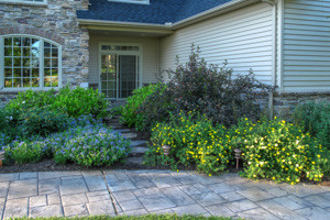 Secluded stepping stone path through mixed plantings for access to game room