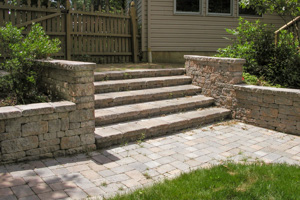 Paver steps and wing walls solution to backyard slope problem