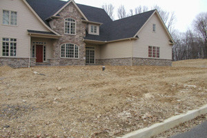 House front bare soil before landscaping Berks County Pennsylvania