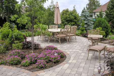 Hardscape and plantings creating outdoor living dining niche destination