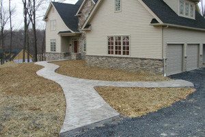 Graceful home front walk stamped concrete just after installation