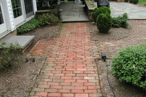 Typical mixed hardscape of various materials; brick walkway, flagstone patio